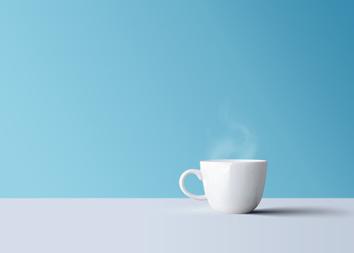 isolated hot black coffee in white coffee mug with smoke
