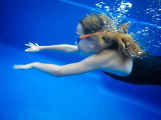 Little girl swimming under water