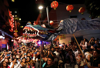 People perform a traditional Chinese dragon dance to mark the Chinese Lunar New Year of the Pig in Chinatown in Mexico City