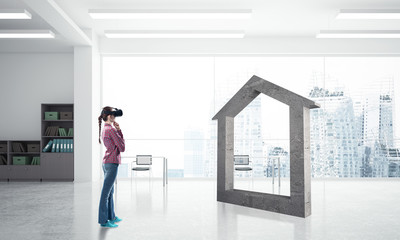 Girl in virtual reality mask experiencing virtual technology world. Mixed media