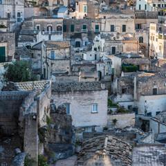 Sassi of Matera. Sasso Barisano at sunset. Magic of cave houses. UNESCO World Heritage Site.