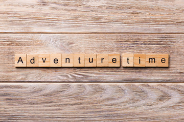 Adventure time word written on wood block. Adventure time text on wooden table for your desing, concept