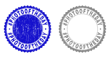 Grunge #PHOTOOFTHEDAY stamp seals isolated on a white background. Rosette seals with grunge texture in blue and grey colors. Vector rubber stamp imitation of #PHOTOOFTHEDAY label inside round rosette.