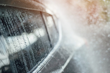 Car wash business banner concept. Cleaning and Spray water Washing Car.  soft focus.