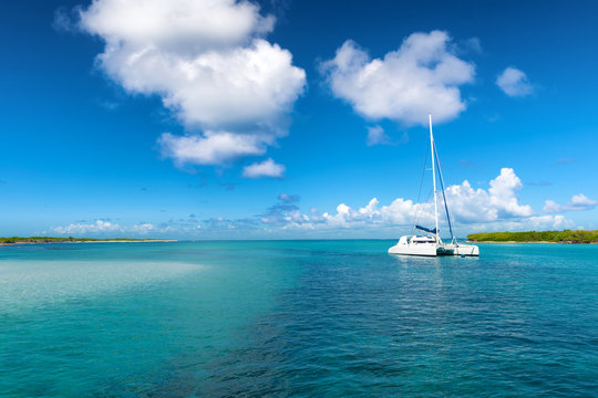 Catamaran mooring near Petite terre, Guadeloupe, French West Indies, blue sky background