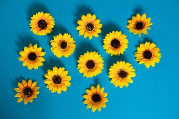 Artificial sunflowers of blue background