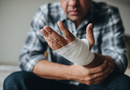 Man with a gauze bandage wrapped around his hand