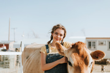 Happy woman with a cow