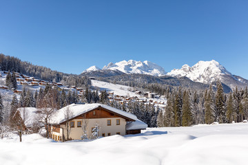 Snow-covered cottages at the Austrian Alps. Winter landscape