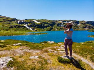 Tourist taking photo in norwegian nature