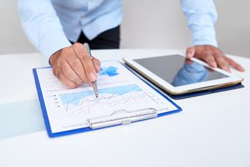 Businessman analyzing financial chart
