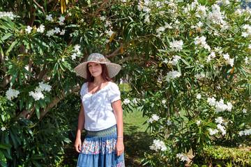 Girl next to a bush with white flowers. Budva, Montenegro