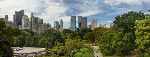 Large panoramic view from Central Park to Manhattan skyscrapers at sunny day. New York City