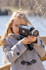 blond little girl playing in the park happy and smiling her camera retro classic