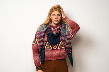 Hippie woman over white wall with an expression of frustration and not understanding