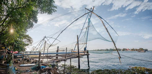 KOCHI, INDIA - OCTOBER 1 , 2018: Ocean coast landscape with chinese fishing nets silhouette at Cochin (Kochi). South India, Kerala, Kochin
