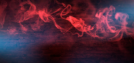 Red Smoke on a dark background. Dark empty room with rays of light, searchlight. Color correction, background.