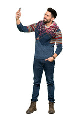Full-length shot of Hippie man making a selfie on isolated white background