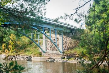 Autumn landscape of bridge and Kymijoki river waters in Finland, Kymenlaakso, Kouvola, Myllykoski.