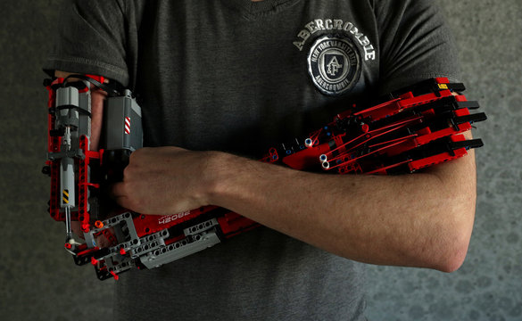 David Aguilar poses with his prosthetic arm built with Lego pieces during an interview with Reuters in Sant Cugat del Valles