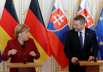 German Chancellor Angela Merkel and Slovakia's Prime Minister Peter Pellegrini give statements during the summit of the Prime Ministers of the Visegrad Group and Germany in Bratislava