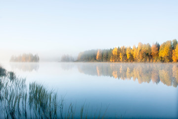 Beautiful autumn morning landscape of Kymijoki river waters in fog. Finland, Kymenlaakso, Kouvola. Wall mural