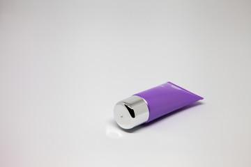 purple closed tube of cream