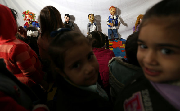 Marionette puppets, made by Palestinian artist Mahdi Karera, are seen during a show at a kindergarten in Gaza City