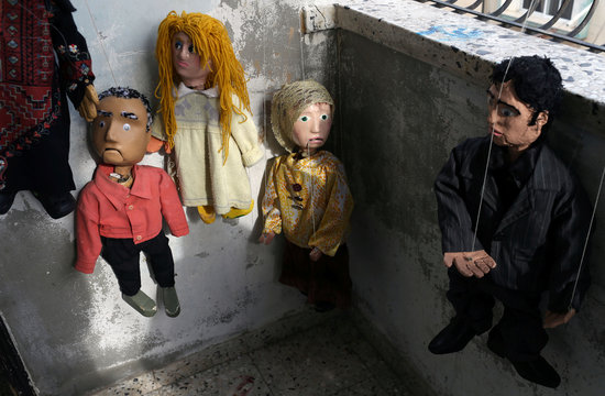 Marionette puppets, made by Palestinian artist Mahdi Karera, are seen at his house balcony in Gaza City