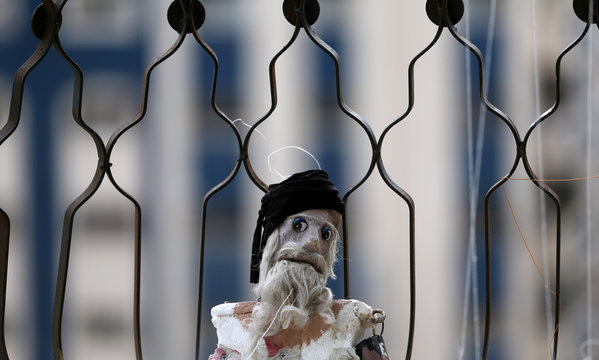Marionette puppet, made by Palestinian artist Mahdi Karera, is seen at his house balcony in Gaza City