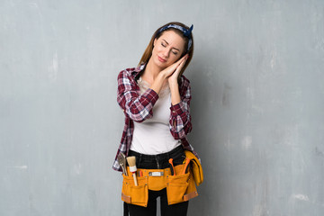 Craftsmen or electrician woman making sleep gesture in dorable expression