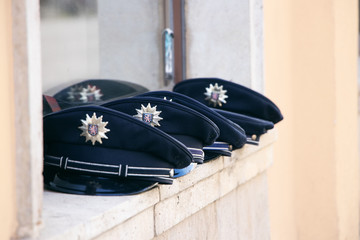 german police hat in a row