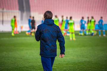 Football head trainer during professional soccer match