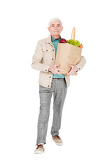 retired man holding paper bag with products isolated on white