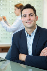 handsome ophthalmologist looking at the camera