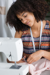 female fashion designer cutting tissue