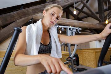 woman setting up exercise machine