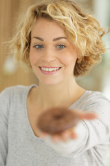 woman showing donut