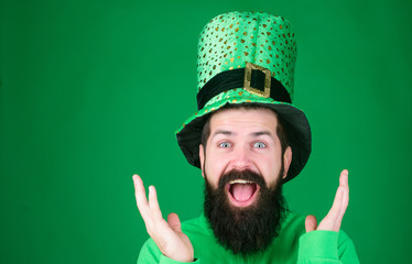 Saint patricks day holiday. Happy patricks day. Global celebration. St patricks day holiday known for parades shamrocks and all things Irish. Man bearded hipster wear hat. Green part of celebration Wall mural