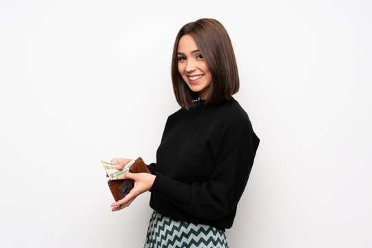 Young woman over white wall holding a wallet