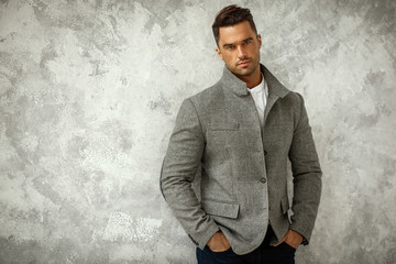 Portrait of handsome man in gray stylish jacket with copy space for your text Wall mural