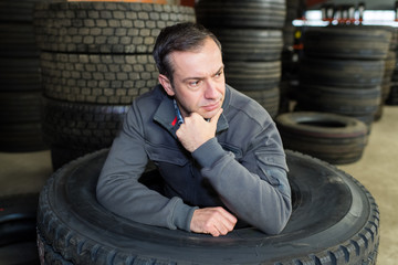auto mechanic man thinking at workshop