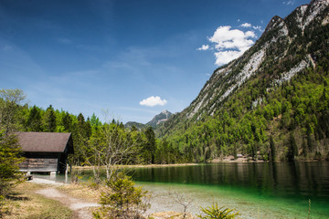 Beautiful panorama on Kenigssee lake.Colorful morning view of the Bavarian Alps on the border of Austria, Germany, Europe.Photo of beautiful landscape.Green water with montains.