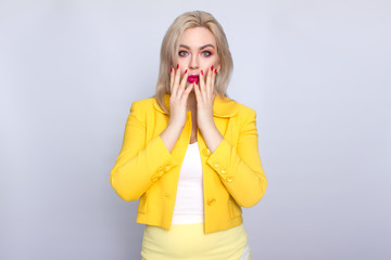373e741b8fb Confident young blonde businesswoman wearing yellow suit standing isolated  over white background