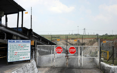 A general picture of a locked gate leading to the entrance of an unused mine shaft, where people have been killed by a gas explosion in South Africa's eastern province of Mpumalanga
