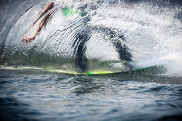 Sillouhette of a wakeboarder through the water Wall mural