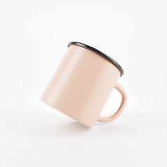Beige enamel metal mug on white background. Blank cup for branding. 3d rendering