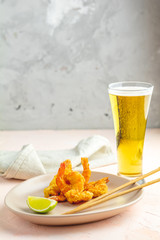 Shrimps tempura in plate and glass of beer