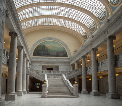 State of Utah Capitol hill complex in Salt Lake City, historic exterior and rotunda dome interior with house, senate and soupreme court chamber, staircase, and paintings, tourist visitors