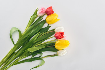top view of bouquet with colorful tulip flowers isolated on grey